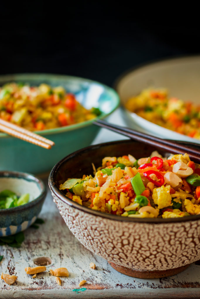 Image of bowl of thai chili fried rice and chopsticks.