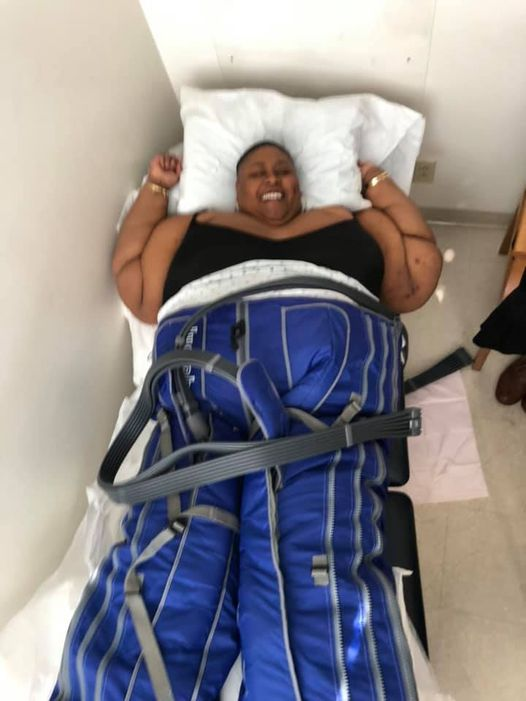 """""""Image of brena jean lying down while having her stomach fat examined for Lipedema."""